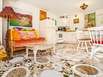A stunning granite mosaic floor by Rachel adorns the lower level of cottage.