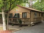 2 bedroom, situated on a private wooded lot w/ a large wraparound deck