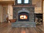 16 foot tall stone, wood burning fireplace!