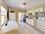 Kitchen - The sun-lit kitchen includes direct access to the backyard, deck and pool!