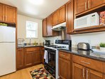 The kitchen is conveniently equipped with microwave, coffee maker, full-sized ref, cooking basics