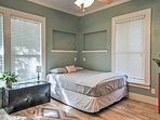 You'll feel right at home in this light and airy bedroom with a plush queen bed.