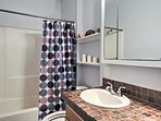 Tasteful decorations add a pop of personality to each bathroom.