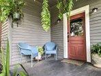 The quaint front porch invites you inside this petite mansion.