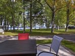Wine and dine al fresco on the furnished patio with lake views.