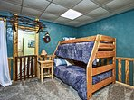 The kids can enjoy peaceful slumbers on the twin-over-full bunk bed in the rear bedroom.
