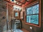 The master en-suite bathroom is equipped with a single vanity and pristine walk-in shower.