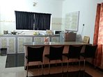 Kitchenette with fridge, microwave, gas stove and dining/seating area