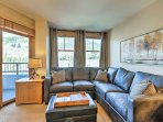 You'll love unwinding on the large plush couch while looking out to mountain views.