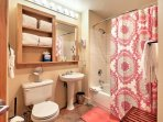 You'll find a shower/tub combo, plenty of towels, and complimentary toiletries in the second full bathroom.