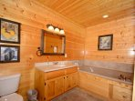 Downstairs Masters Bath with Jacuzzi Tub and walk-in shower.