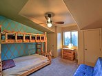 This bedroom provides a twin-over-full bunk bed and a full-sized sofa bed.