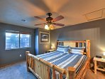 The master bedroom boasts a comfortable king-sized bed.