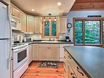 Meals will be a breeze in the fully equipped kitchen, which features ample counter space, an island bar, and updated...