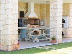Barbecue area with dining table