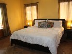 Master bedroom with ac, fan, king bed, private bathroom, plenty of closet space, access to backyard
