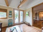 Sun Room, Door opens to Deck and Opens into Dining and Kitchen Area