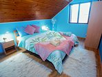Cozy bedroom with soft bed linen and warm blankets for cooler nights