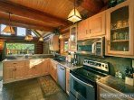 Kitchen with Stainless Steel Appliances at Waters Edge Lodge