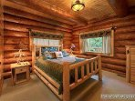 Main Level Bedroom with Queen Bed at Waters Edge Lodge