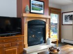 Flat screen TV and gas fireplace offer hours of entertainment