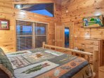 This top floor bedroom has a vaulted ceiling.
