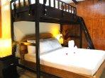 Bedroom 2: Queen size bed with single top bunk.