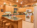 The kitchen is spacious and conveniently stocked with all you need for making meals!