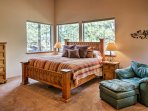 Retreat to the master bedroom where you'll rest easy in the king-sized bed.