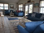 Newly decorated living area with nautical decor. Two sofa sleepers, two loveseats