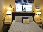 Beautifully decorated queen size bed,cable TV, door to outside patio!