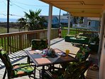 Enjoy breakfast outside, or play cards, relax and watch the waves!