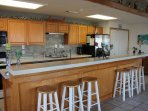 Fabulous kitchen with Quartz counter-top, tile back-splash, single sink, great for entertaining!