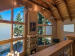 The tall ceilings and wall of windows make for an impressive setting for living area lounging.