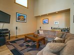 The Living Area features a flat screen TV and sound system for evening entertainment.