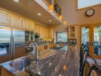 The modern kitchen features everything you need to feed the family, including double ovens, a gas stove, and a...