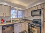The kitchen comes complete with stainless steel appliances and granite countertops.