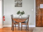 Share your morning coffee at this fold-leaf table.