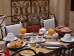 Start the day with an energetic Moroccan breakfast in the patio...