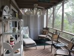 Other end of porch has lounger and chairs for relaxing. Great place for morning coffee.