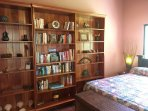 Built in bookshelf in 2nd bedroom, tastefully decorated.
