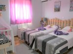 BEDROOM 1 beds can be used as single or as double. Baby cot is provided on request
