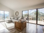 Incredible natural light and long range views from the stylish living room.