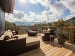 Fantastic space out on the back deck with long range views and comfortable outdoor furniture for total relaxation.