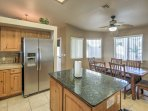 The full kitchen provides a large center-island and stainless steel appliances.