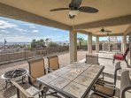 Dine al fresco in the covered patio with ceiling fans.