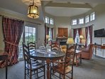 Four guests can eat together at the table in the dining area.