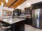 Gourmet kitchen, granite countertops, stainless steel appliances