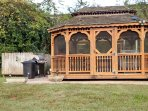 On nice evenings, gather in the gazebo that comfortably sits 8.