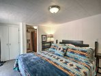 The master bedroom boasts a plush king bed and private en-suite bath.